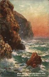 Rocky Shoreline with Wavy Water Against Pastel Sky
