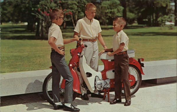 Boys with MOped - McNair Clothing Manufacturing Co. Brownsville Texas