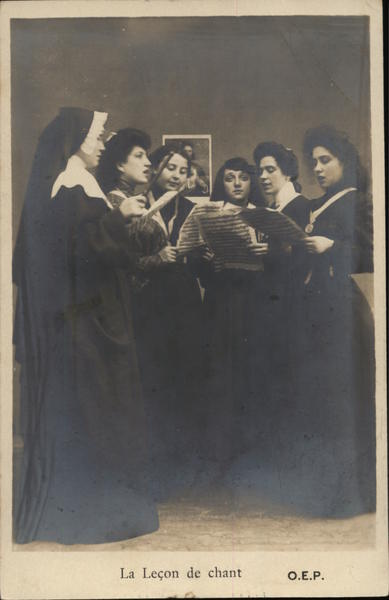 A Nun And Five Ladies Hold Music Sheets Performers & Groups