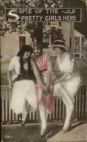 Three Ladies Sit On a Fence Railing Women