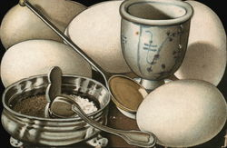 Boiled eggs, egg cup, salt and pepper
