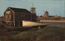 Windmill, Boats, and House on Stilts