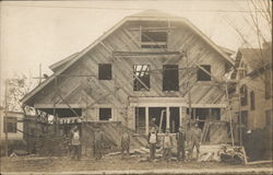 Men Constructing a Large House