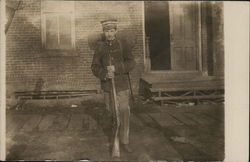 Young Man in Uniform with Rifle