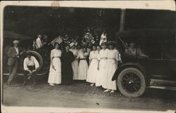 Women In White Posing by Cars