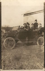 Group of People in Old Car