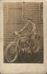 Man on Early 1900s Harley Davidson
