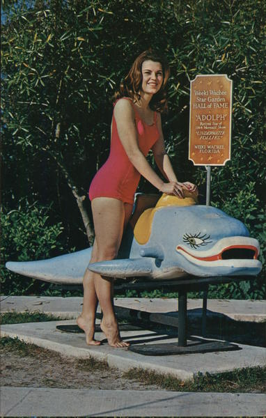 A Weeki Wachee Mermaid Poses with Adolph Florida