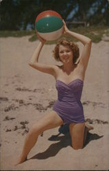 Woman in a Violet Swimsuit With Beachball