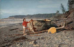 Woman on the Beach With Lifeboat