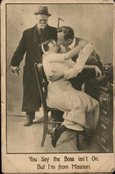 Man Looking on as another man kisses a woman
