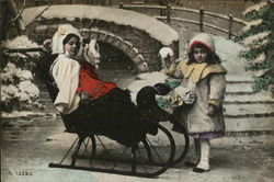Two Girls, one in a sleigh