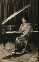 Philippine Woman Seated at a Piano