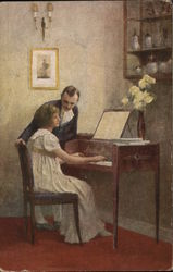 Woman plays piano as man looks on