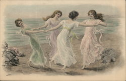 Four whimsically dressed young ladies dancing in a circle on the beach.