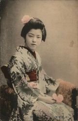 Seated Geisha Holding Single Blossom