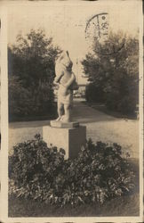 Statue of Boy With Fish