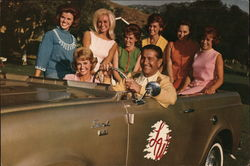 Lawrence Welk with Women in Jeep Scout
