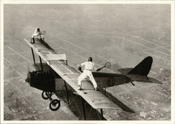 Ivan Unger and Gladys Roy Playing Tennis on Wings of Airplane in Flight, 1925