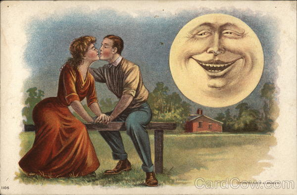A young man and woman kiss on a park bench by the light of a grinning full moon