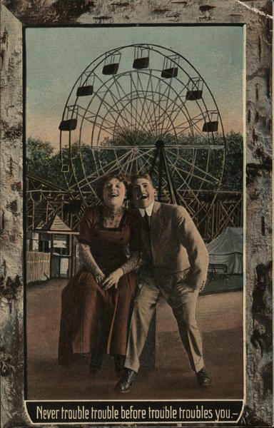 Couple in Front of Ferris Wheel Amusement Parks