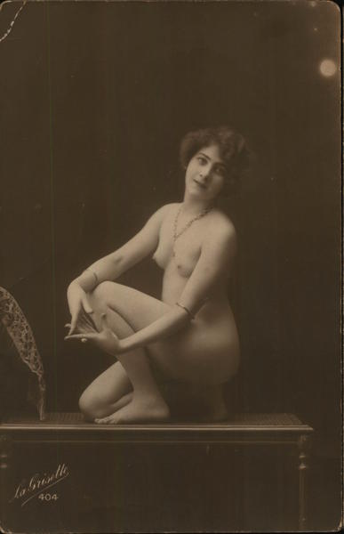 Naked Woman Posing on Table Risque & Nude