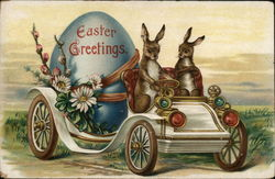 Two Bunnies Driving Easter Egg Carraige