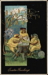 Easter Greetings - three chickens playing cards on a stump.