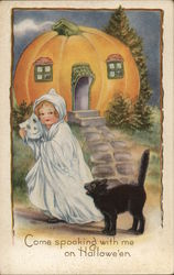 Child dressed as a Ghost with Cat and a Pumpkin shaped House