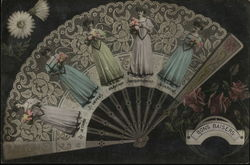 "Lace handheld fan with pictures of a French woman. Bon Baisers - ""Good Kisses"""