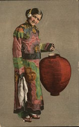 Asian girl in traditional garb holding red lantern
