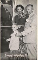 "Mr. and Mrs. Harold Warp and Son ""Skipper"" Cutting Ribbon on Opening of Harold Warp Pioneer Village"