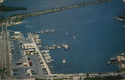 Airview of Small Boat Marina with Causeway in Background