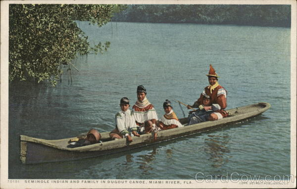 Seminole Indian and Family in Dugout Canoe Miami Florida