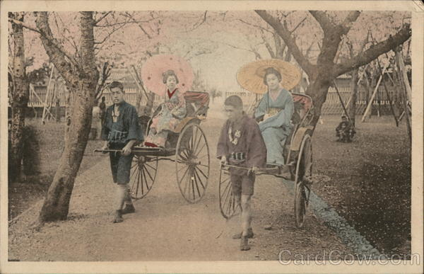 Japanese women being pulled in rickshaws