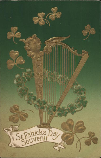 St. Patrick's Day Souvenir. A harp surrounded by green and gold three-leaf clovers.