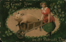 A large pig in a wheelbarrow bushed by a woman.