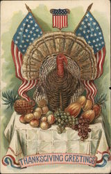 Turkey on a table surrounded by fruits. Two American flags.