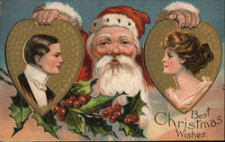 Santa hold shaped pictures of a man and a woman.
