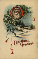 Christmas Greetings. Santa's face above a snow-capped cabin.