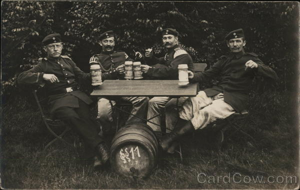Soldiers Drinking Seated Around Table Germany