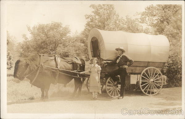 Cowboy and Girl By Oxen Pulled Covered Wagon Iowa Cowboy Western