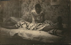 Photo of Two Men in Bed - One with Gun