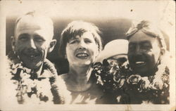 Two Men and a Woman with Leis