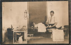 Doctor Working on Patient Postcard