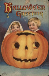 Two Children and Jack O'Lantern