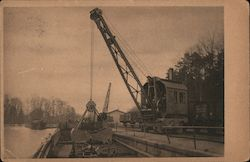 """Ardelt"" Locomotive-steam-crane with grab shifting coal from Barge into Truck. Postcard"
