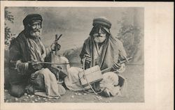 Two old men playing Cigar Box Instruments