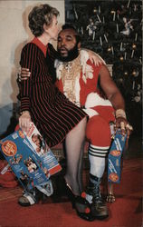 Nancy Reagan Sitting on Mr. T's Lap at Christmas