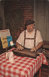 Mr. Willie Dittrich plays a zither, an instrument very popular in old Germany